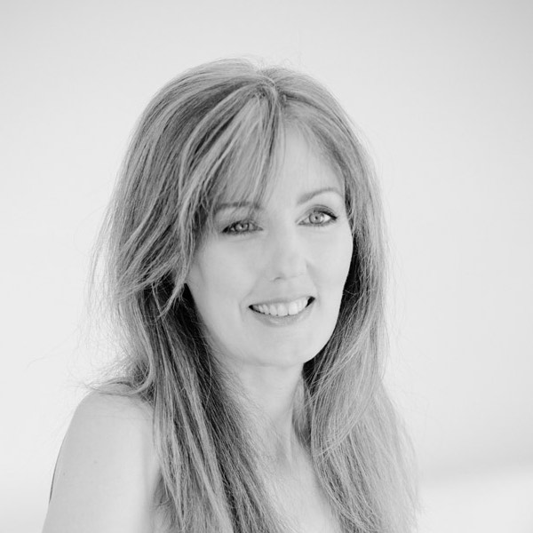 Image shows a black and white close up of Rachel Amphlett posed in a studio wearing a spaghetti strap top