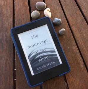 Kindle showing Louise Beech Mountain in My Shoe published by Orenda Books plus shells
