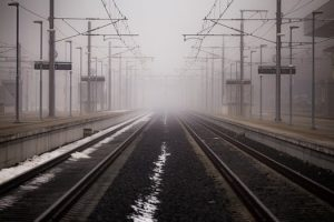 Train station and railway tracks in fog