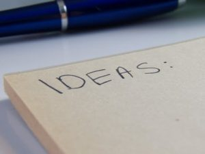 ideas written on a notepad