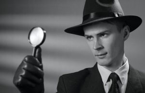 Black and white photo of a 1950s detective