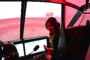 Rachel Amphlett flying helicopter simulator for research
