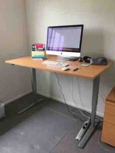 Sit stand desk in office