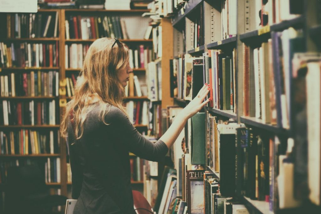 woman browsing library shelf