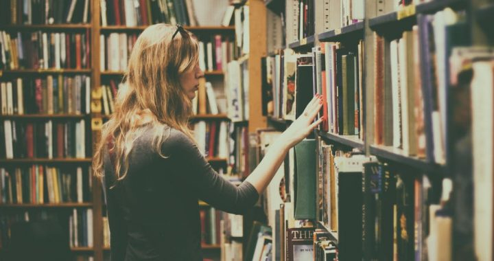 woman browsing library shelf
