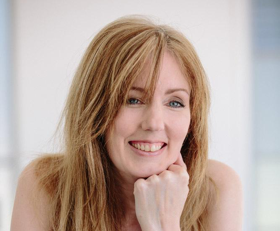 Image shows Rachel Amphlett posed in a studio wearing a pink spaghetti strap top