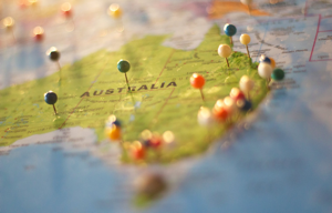 Image shows a map of Australia with coloured pins stuck in it