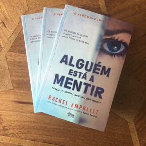 Image shows three print copies of The Friend Who Lied Portuguese translation Alguem esta a Mentir stacked on top of each other face up