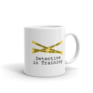 Image shows coffee mug with yellow crime scene tape and the words Detective In Training underneath