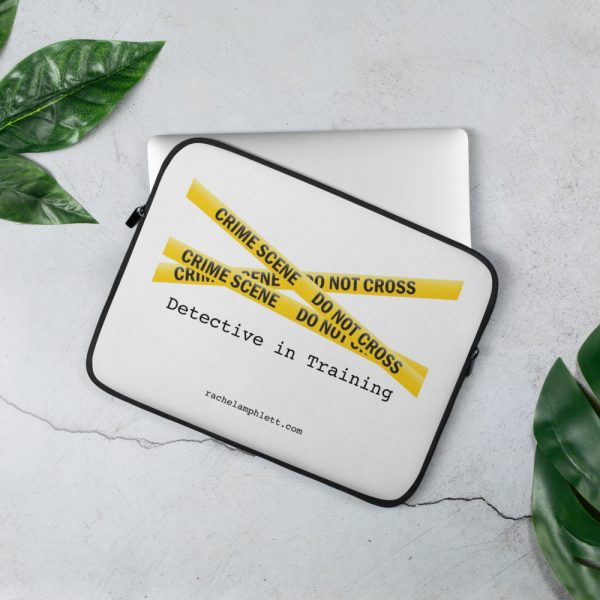 Image shows laptop case with yellow crime scene tape and the words Detective in Training