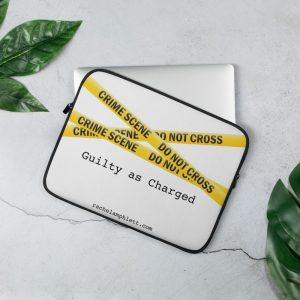 Laptop cover with yellow crime scene tape and text Guilty as Charged