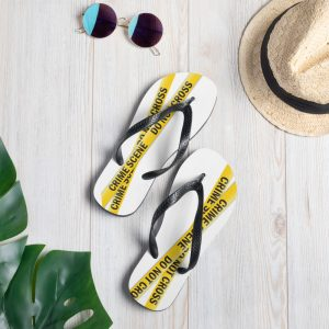 Image shows white flip flops (thongs) with black straps and yellow crime scene tape printed on the uppers