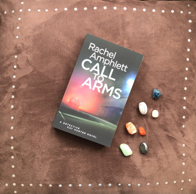 Call to Arms book resting on a brown velvet background