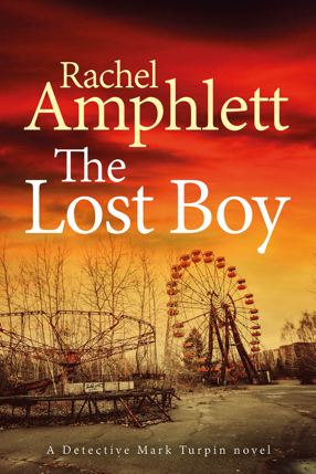 Image shows the cover for The Lost Boy with abandoned fairground rides against an orange and yellow sky